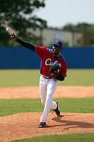 Jose Luis Maulin works out at the Dominican Republic air force base in front of 100+ Major League Baseball scouts prior to being declared eligible to sign since defecting from his native Cuba in Santo Domingo, Dominican Republic on February 11, 2015 (Bill Mitchell)