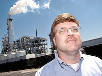 """PAULSBORO, NJ - MAY 9:  Mike Pesch, VP/General Manager of the Valero Paulsboro Refinery speaks about the refinery while standing in front of the """"scrubber"""" which removes sulpher and other pollutants from the emissions May 9, 2005 in Paulsboro, New Jersey. (Photo by William Thomas Cain)"""
