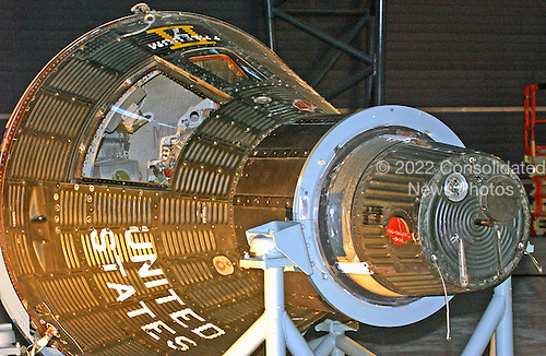 Chantilly, VA - December 5, 2003 -- This spacecraft was slated for a seventh Manned mission, Mercury 10,  with Alan B. Shepard, Jr. aboard and still bears the logo Freedom 7 II.   L. Gordon Cooper Jr. was to be the back-up.  Mercury 10 was originally planned to be the first one-day Mercury flight. This objective was later assigned to Mercury 9 and Mercury 10 then became the second one-day flight.  Due to budgetary pressures, NASA and the Mercury managers had to decide whether to undertake another flight after Cooper's planned 22 orbit Mercury 9 mission.  At the end of Cooper's flight there was enough oxygen remaining for five days, six days left until his capsule decayed from orbit, and enough attitude control propellant for another two days. Walter Williams, Alan Shepard, and others at the Manned Spacecraft Center (MSC) pushed for a three to six day Mercury 10 endurance mission. This would give America the manned space endurance record for the first time and cover the biological objectives of the first two Gemini missions. The Mercury 15B capsule had already been modified for long-duration flight and Shepard had the name 'Freedom 7 II' painted on the side. But the risk and work pending on Gemini, which was running late and over budget,  persuaded NASA managers not to undertake another mission unless Mercury 9 failed. The massive breakdown of nearly all systems aboard Mercury 9 convinced NASA that this was the right decision. Their risk assessment was also influenced by Martin Caidin's novel, Marooned. In the book, Mercury 10's retrorockets fail, stranding its astronaut  in orbit. He is saved by the combined efforts of NASA Gemini and Russian modified Vostok spacecraft. Such resources were not available in real life.  Astronaut Shephard was removed from flight status in October 1963 due to Meniere's syndrome. If Mercury 10 had flown, it might well have been piloted by Cooper. .Credit: Ron Sachs / CNP.(RESTRICTION: NO New York or New Jersey Newspapers or newspapers w