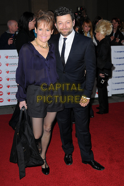 LORRAINE ASHBOURNE & ANDY SERKIS .The Co-operative Variety Club Showbiz Awards, Grosvenor House Hotel, Park Lane, London, England, UK, .14th November 2010. .full length black  blue navy suit tie shirt blouse shirts tights couple married husband wife sheer see thru through bra .CAP/CAS.©Bob Cass/Capital Pictures.