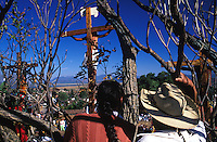 A couple look on as jesus´crucifiction is re-enacted for holy week (Semana Santa) in Erongaricuaro, Michoacan, Mexico