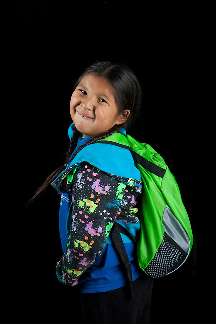 Native American elementary age girl with school back pack. Rose Brown (Shoshone Bannock)
