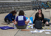 Anti-Kavanagh protestors sit on the sidewalk creating protest signs just outside the grounds of the United States Capitol in Washington, DC as the US Senate floor statements continue inside the building on Saturday, October 6, 2018. <br /> Credit: Ron Sachs / CNP<br /> RESTRICTION: NO New York or New Jersey Newspapers or newspapers within a 75 mile radius of New York City)