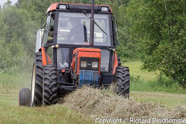 Farm tractor in hay field