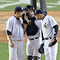 (L-R) Masahiro Tanaka, Brian McCann, Derek Jeter (Yankees),<br /> APRIL 27, 2014 - MLB :<br /> Pitcher Masahiro Tanaka of the New York Yankees talks with catcher Brian McCann and Derek Jeter during the Major League Baseball game against the Los Angeles Angels at Yankee Stadium in Bronx, New York, United States. (Photo by AFLO)