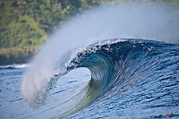 An empty wave breaks on a reff pass near Teahupoo, Tahiti, (Friday May 15 2009.) Photo: joliphotos.com