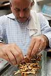 Chef Raphael Lunetta preparing roasted maitake mushrooms at JiRaffe Restaurant, Santa Monica, CA