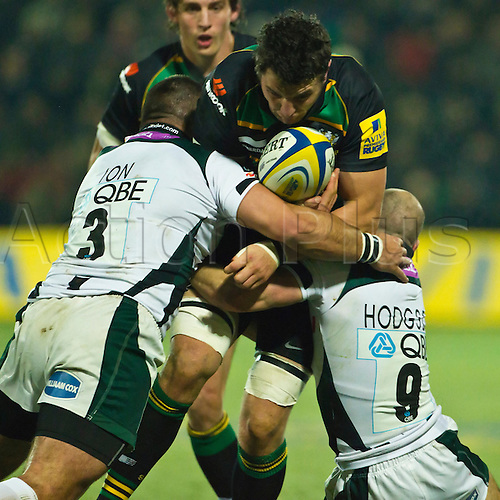 Jon Clarke is tackled by Paulica Ion and Paul Hodgson.  Northampton Saints v London Irish, Aviva Premiership, 26 November 2010 at Franklin's Gardens.  Final score: Northampton Saints 35-23 London Irish.