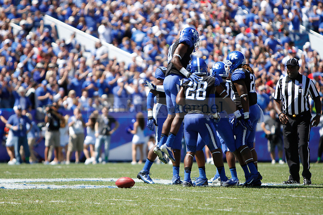 UK corner back Nate Willis celebrates a good play during the first half of the UK football game against UofL in Commonwealth Stadium in Lexington, Ky., on Saturday, September 14, 2013. Photo by Eleanor Hasken   Staff