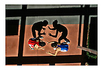 2004 David Burnett/Contact Press Images.July 7 2004 Colorado Spgs CO.Two American Olympic contenders, Patricia Miranda (red) and Tela OConnell (blue) make dancing shadows at the US Olympic Training facility in Colorado Springs.
