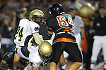 Beverly Hills, CA 09/23/11 - Okuoma Idah (Peninsula #24), Joey Augello (Peninsula #58) and Leonard Ferdman (Beverly Hills #64) in action during the Peninsula-Beverly Hills Varsity football game.