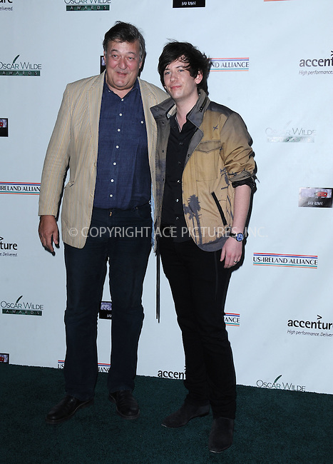 WWW.ACEPIXS.COM<br /> <br /> February 19 2015, LA<br /> <br /> Actor Stephen Fry (L) and his husband Elliott Spencer arriving at the US-Ireland Alliance Pre-Academy Awards event at Bad Robot on February 19, 2015 in Santa Monica, California. <br /> <br /> <br /> By Line: Peter West/ACE Pictures<br /> <br /> <br /> ACE Pictures, Inc.<br /> tel: 646 769 0430<br /> Email: info@acepixs.com<br /> www.acepixs.com