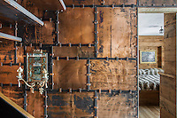 Detail of the stapled copper panels which make up the stairwell designed by Giancarlo Candeago