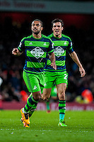 ( L-R ) Wayne Routledge of Swansea City  and Jack Cork of Swansea City  celebrate during the Barclays Premier League match between Arsenal and Swansea City at the Emirates Stadium, London, UK, Wednesday 02 March 2016