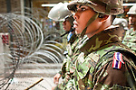 Apr. 19 2010 - BANGKOK, THAILAND: Thai soldiers on duty behind a wall of razor wire in the Silom financial district in Bangkok Monday. Hundreds of Thai soldiers, including reservists and front line units, and riot police moved into the Silom financial district Monday, not far from the red-shirts' main protest rally site, in Ratchaprasong. The heavy show of force is to prevent the Red Shirts from entering the Silom area. Many of soldiers were greeted as heros by workers in the area, who oppose the Red Shirts.   Photo by Jack Kurtz