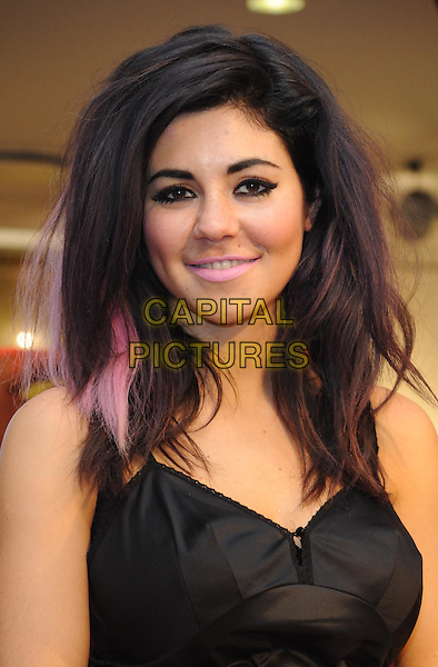 MARINA DIAMANDIS of MARINA AND THE DIAMONDS .Marina Diamandis at Esprit's Big Bang Celebrations at the Espirt store on Regent Street, London, England..November 13th, 2010.headshot portrait black top pink highlights streaks hair eyeliner make-up beauty.CAP/WIZ.© Wizard/Capital Pictures.