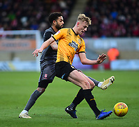 Cambridge United's Harry Darling shields the ball from  Lincoln City's Bruno Andrade<br /> <br /> Photographer Andrew Vaughan/CameraSport<br /> <br /> The EFL Sky Bet League Two - Cambridge United v Lincoln City - Saturday 29th December 2018  - Abbey Stadium - Cambridge<br /> <br /> World Copyright © 2018 CameraSport. All rights reserved. 43 Linden Ave. Countesthorpe. Leicester. England. LE8 5PG - Tel: +44 (0) 116 277 4147 - admin@camerasport.com - www.camerasport.com