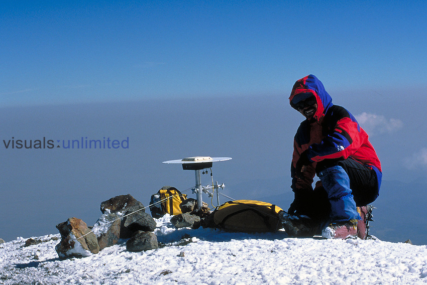 Volcanologist obtaining GPS coordinates of Popocatepatl, a large active volcano outside Mexico City, Mexico.