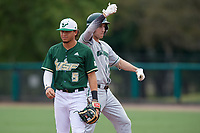 Dartmouth Big Green Matt Feinstein (23) celebrates after hitting a double, behind Jordan Santos (5), during a game against the USF Bulls on March 17, 2019 at USF Baseball Stadium in Tampa, Florida.  USF defeated Dartmouth 4-1.  (Mike Janes/Four Seam Images)