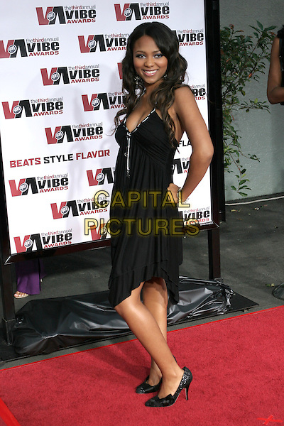TEAIRRA MARI.The 2005 Vibe  Awards held at Sony Studios. Culver City, California..USA, United States..12th November 2005.Ref:ADM/ZL.half length black dress asymetric hem hand on hip smiling posed.www.capitalpictures.com.sales@capitalpictures.com.© Capital Pictures..