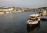 Evening light boats buildings, River Maas or Meuse, Maastricht, Limburg province, Netherlands,