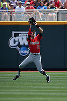 Devon Conley #28 of the Texas Tech Red Raiders fields during Game 3 of the 2014 Men's College World Series between the Texas Tech Red Raiders and TCU Horned Frogs at TD Ameritrade Park on June 15, 2014 in Omaha, Nebraska. (Brace Hemmelgarn/Four Seam Images)