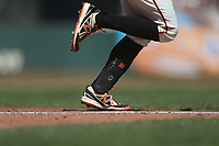 SAN FRANCISCO, CA - SEPTEMBER 15:  Detail of New Era cleats belonging to Evan Longoria #10 of the San Francisco Giants as he bats and runs to first base against the Miami Marlins during the game at Oracle Park on Sunday, September 15, 2019 in San Francisco, California. (Photo by Brad Mangin)