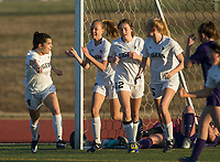 NWA Democrat-Gazette/BEN GOFF @NWABENGOFF<br /> Tyler Ann Reash (from left), Ginger Olson, Meagan Gotwalt and Sydney Suggs of Bentonville celebrate a goal by Olson against Fayetteville Tuesday, March 13, 2018, during the match at Bentonville's Tiger Athletic Complex.
