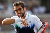 Marin Cilic of Croatia reacts during his game against Roger Federer of Switzerland during men semifinal match at the US Open 2014 tennis tournament in the USTA Billie Jean King National Center, New York.  09.05.2014. VIEWpress