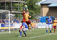 Robby McCrorie saves under strong pressure from James Scott in the SPFL Betfred League Cup group match between Queen of the South and Motherwell at Palmerston Park, Dumfries on 13.7.19.