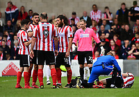 Lincoln City's Scott Wharton receives treatment for an injury from Lincoln City's head of sports science and medicine Mike Hine<br /> <br /> Photographer Chris Vaughan/CameraSport<br /> <br /> The EFL Sky Bet League Two Play Off First Leg - Lincoln City v Exeter City - Saturday 12th May 2018 - Sincil Bank - Lincoln<br /> <br /> World Copyright &copy; 2018 CameraSport. All rights reserved. 43 Linden Ave. Countesthorpe. Leicester. England. LE8 5PG - Tel: +44 (0) 116 277 4147 - admin@camerasport.com - www.camerasport.com