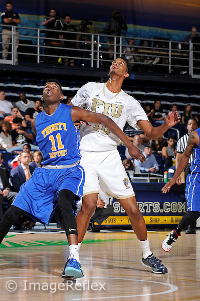 13 November 2015:  FIU Forward Hassan Hussein (10) positions for a rebound in the second half as the FIU Golden Panthers defeated the Trinity Baptist College Eagles, 71-39, at FIU Arena in Miami, Florida.