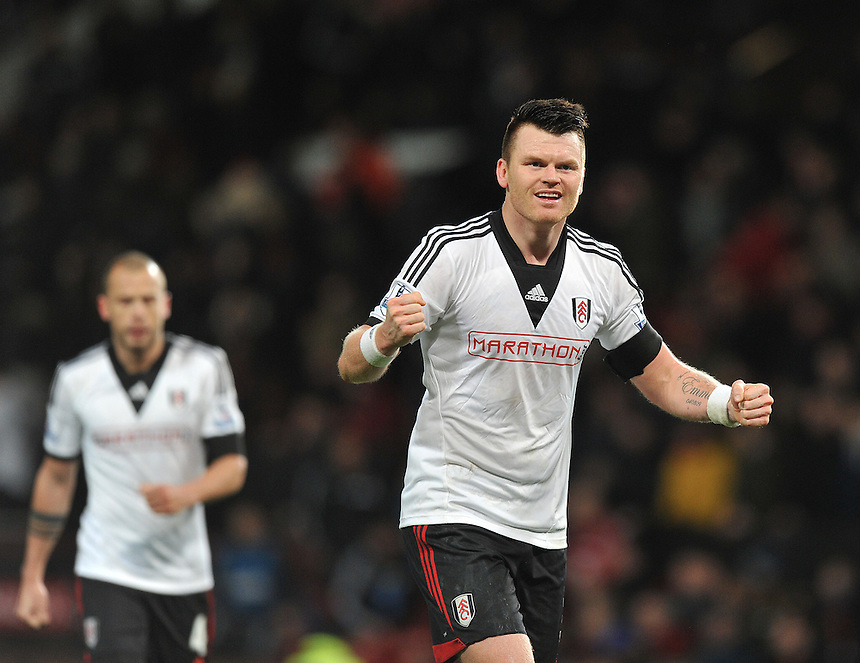 Fulham's John Arne Riise celebrates at the final whistle<br /> <br /> Photo by Dave Howarth/CameraSport<br /> <br /> Football - Barclays Premiership - Manchester United v Fulham - Sunday 9th February 2014 - Old Trafford - Manchester<br /> <br /> &copy; CameraSport - 43 Linden Ave. Countesthorpe. Leicester. England. LE8 5PG - Tel: +44 (0) 116 277 4147 - admin@camerasport.com - www.camerasport.com