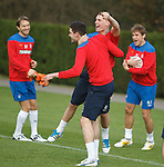 Gregg Wylde and Kyle Lafferty celebrate at training