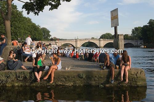 Richmond Upon Thames, Surrey, England 2007. Tourists enjoying a drink Riverside. Richmond bridge.