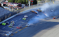 Apr. 24, 2009; Talladega, AL, USA; ARCA RE/MAX Series driver Justin Lofton leads the field as a multi car accident occurs behind during the RE/MAX 250 at the Talladega Superspeedway. Mandatory Credit: Mark J. Rebilas-