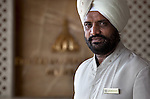 MUMBAI, INDIA - SEPTEMBER 27, 2010:  One of the turbaned door staff welcomes guests at the Taj Mahal Palace and Tower Hotel in Mumbai. The Hotel has re-opened after the terror attacks of 2008 destroyed much of the heritage wing. The wing has been renovated and the hotel is once again the shining jewel of Mumbai. pic Graham Crouch