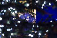 General view of Stamford Bridge Stadium, home of Chelsea Football Club, with a Home Chelsea Shirt tree seen through a Christmas Tree outside the ground, ahead of the UEFA Champions League group match between Chelsea and FC Porto at Stamford Bridge, London, England on 9 December 2015. Photo by David Horn / PRiME
