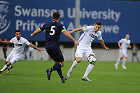 Monday 20th August 2018<br /> Pictured: Swansea City's Adnan Maric vies for possession with Derby County's Ethan Wassall<br /> Re: Swansea City U23 v Derby County U23 Premier League 2 match at the Landore Training facility, Swansea, Wales, UK