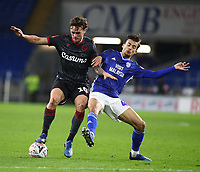 4th February 2020; Cardiff City Stadium, Cardiff, Glamorgan, Wales; English FA Cup Football, Cardiff City versus Reading; John Swift of Reading holds back the challenge from Thomas Sang of Cardiff City
