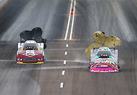 Feb 20, 2015; Chandler, AZ, USA; NHRA funny car driver Courtney Force (right) slows alongside Tim Wilkerson during qualifying for the Carquest Nationals at Wild Horse Pass Motorsports Park. Mandatory Credit: Mark J. Rebilas-