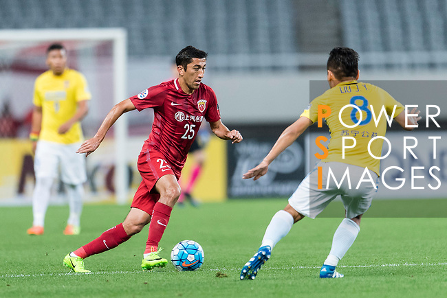 Shanghai FC Midfielder Akhmedov Odil (L) in action during the AFC Champions League 2017 Round of 16 match between Shanghai SIPG FC (CHN) vs Jiangsu FC (CHN) at the Shanghai Stadium on 24 May 2017 in Shanghai, China. Photo by Marcio Rodrigo Machado / Power Sport Images