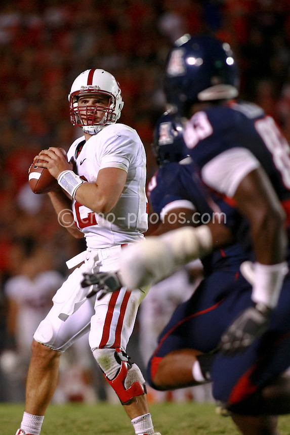 Oct 17, 2009; Tucson, AZ, USA; Stanford quarterback Andrew Luck (12) surveys the field from the pocket late in the 4th quarter of a game against the Arizona Wildcats at Arizona Stadium.  Arizona defeated Stanford 43-38.