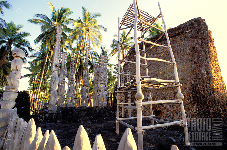 Wooden statues and hale at Puuhonua Honaunau, city of refuge, near Kealakekua bay, a national historic park on the Big  island