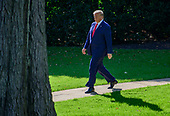 United States President Donald J. Trump walks from the Oval Office prior to taking questions from the media as he prepares to depart the South Lawn of the White House in Washington, DC to deliver remarks at a Keep America Great Rally in Minneapolis, Minnesota on Thursday, October 10, 2019.<br /> Credit: Ron Sachs / CNP