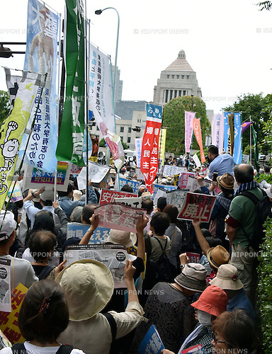 June 5, 2016, Tokyo, Japan - Hundreds of concerned citizens and unionists carry with them placards and banners during a demonstration around the Diet in Tokyo on Sunday, June 5, 2016, calling for cooperation of oppositions to the Administration of Japans Prime Minister Shinzo Abe in the upcoming parliamentary election. Japan will go to the polls on July 10 in the ?triennial upper house election, in which half the chambers 242 seats come up for grabs. (Photo by Natsuki Sakai/AFLO) AYF -mis-
