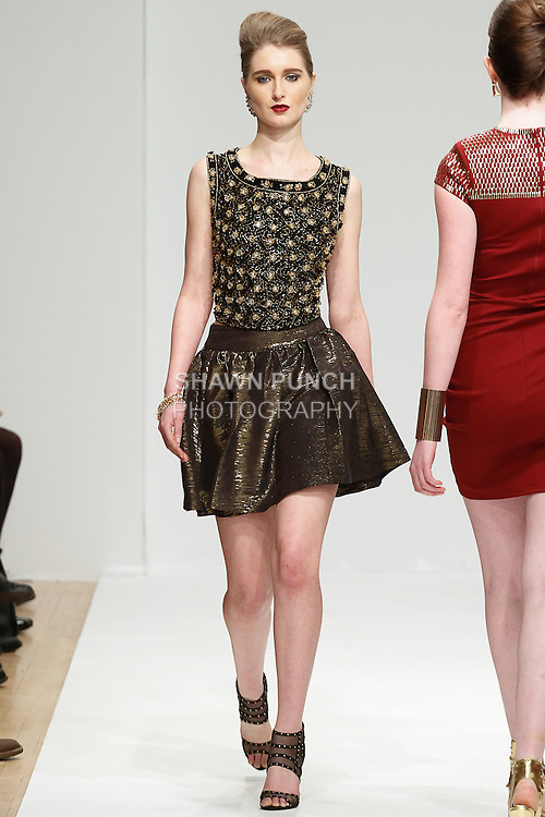 Model walks runway in an outfit from the Sacred Heart Collections Fall 2014 runway show by Brandi Russell, at the Designer's Review Fall 2014, during Fashion Gallery Fashion Week Fall 2014, on February 8, 2013.