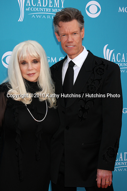 Randy Travis & Wife.arrives at the Academy of Country Music Awards 2010.MGM Garden Arena.Las Vegas, NV.April 18, 2010.©2010 Kathy Hutchins / Hutchins Photo....