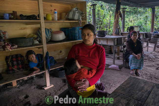 November 21, 2014.<br /> Eulalia Angelina Pablo, 29 years old, is one of the women who is everyday at the camp of resistance in Santa Cruz de Barillas (Guatemala). They keep out that the machines of the spanish company Ecoener could not enter to the Mayan territory, on november 21, 2014. The arrival of foreign companies to Latin America has provoked abuses of the rights of indigenous people and repression of their defense of the environment. In Santa Cruz de Barillas, Guatemala, the project of the Spanish hydroelectric Ecoener has caused murders, violent riots, the declaration of a state of siege by the army and the imprisonment of a dozen activists opposed to the project. They defend their territory and their river, called Cambalam. The river has for the Mayan people a special meaning and it is linked with their ancestors. A group of Mayan Indians, mostly women, has cut a path and has installed a resistance camp to prevent the enter of the company&rsquo;s machines. The prosecution has also provoked that some ecologists, with orders for their arrest, have been hidden for months in the Guatemalan jungle.<br /> <br /> In Coban, place located also in Guatemala, the hydroelectric Renace has been installed with threats to the population and false promises of development for the area. The company has also forbidden the access to the river for thousands of people and has no respected the close relationship of the Maya Indians with environment. Renace is a Guatemaltecan company but has given the contract of the  construction of the hydroelectric to the spanish company Cobra. As in Santa Cruz de Barillas, the project has divided the population and has caused riots. The project has very close families that live in extrem poverty. They are people that leave close to the hydroelectric but they don&rsquo; t have electricity at home. &copy;Calamar2/ Pedro ARMESTRE