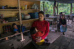 November 21, 2014.<br /> Eulalia Angelina Pablo, 29 years old, is one of the women who is everyday at the camp of resistance in Santa Cruz de Barillas (Guatemala). They keep out that the machines of the spanish company Ecoener could not enter to the Mayan territory, on november 21, 2014. The arrival of foreign companies to Latin America has provoked abuses of the rights of indigenous people and repression of their defense of the environment. In Santa Cruz de Barillas, Guatemala, the project of the Spanish hydroelectric Ecoener has caused murders, violent riots, the declaration of a state of siege by the army and the imprisonment of a dozen activists opposed to the project. They defend their territory and their river, called Cambalam. The river has for the Mayan people a special meaning and it is linked with their ancestors. A group of Mayan Indians, mostly women, has cut a path and has installed a resistance camp to prevent the enter of the company's machines. The prosecution has also provoked that some ecologists, with orders for their arrest, have been hidden for months in the Guatemalan jungle.<br /> <br /> In Coban, place located also in Guatemala, the hydroelectric Renace has been installed with threats to the population and false promises of development for the area. The company has also forbidden the access to the river for thousands of people and has no respected the close relationship of the Maya Indians with environment. Renace is a Guatemaltecan company but has given the contract of the  construction of the hydroelectric to the spanish company Cobra. As in Santa Cruz de Barillas, the project has divided the population and has caused riots. The project has very close families that live in extrem poverty. They are people that leave close to the hydroelectric but they don' t have electricity at home. ©Calamar2/ Pedro ARMESTRE